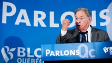 Former Quebec premier Jacques Parizeau speaks during a Bloc Quebecois campaign stop in Longueuil, Que., Monday, April 25, 2011. THE CANADIAN PRESS / Graham Hughes