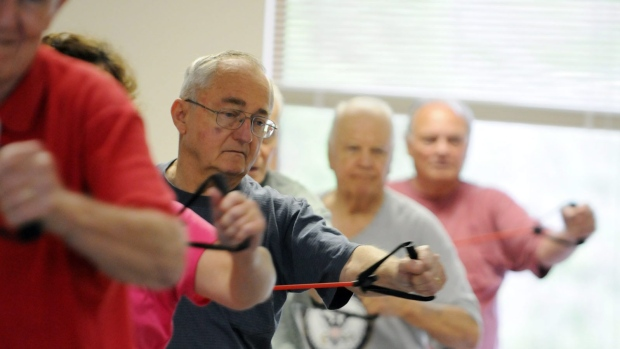 Fitness instructor Fran Tabor leads a men's group exercise class at the Senior Resource Center in Wilmington, N.C. Wednesday, April 18, 2012. (AP Photo/The Star-News, Mike Spencer)