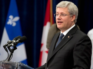 Prime Minister Stephen Harper speaks at the Institut National d'Optique as it celebrates its 25th anniversary in Quebec City, Monday, Sept. 30, 2013. (Jacques Boissinot / THE CANADIAN PRESS)