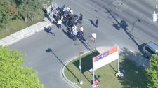 The CTV News helicopter captures Canada Post workers picketing outside a facility in Toronto on Tuesday, June 14, 2011.