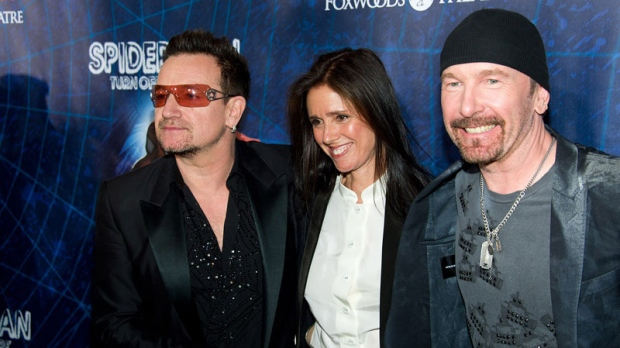 Bono, left, Julie Taymor and The Edge arrive at the opening night performance of the Broadway musical 'Spider-Man Turn Off the Dark' in New York, Tuesday, June 14, 2011. (AP / Charles Sykes)
