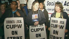 Canada Post workers join picket lines in Toronto, Tuesday, June 14, 2011.