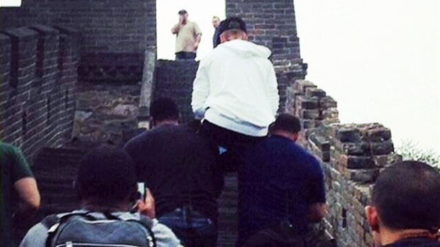 Sleepy Bieber carried up Great Wall of China