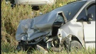 A damaged vehicle is seen following a fatal crash at Calvert Drive and Thames Road in Middlesex County, west of London, Ont. on Tuesday, Oct. 1, 2013.