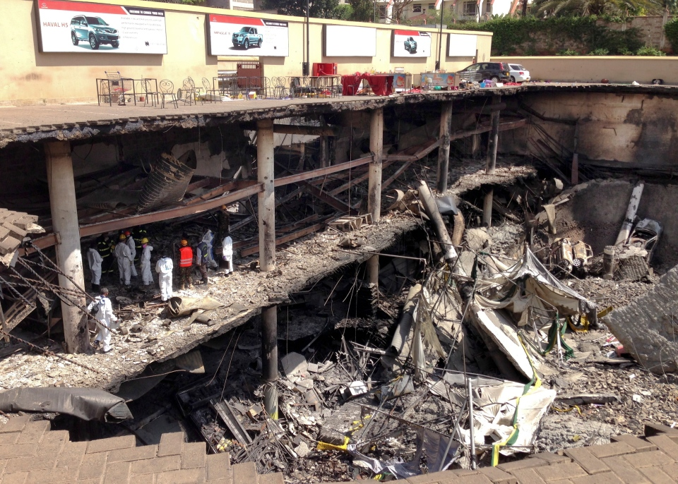 Forensics investigators work next to the collapsed upper car park at the Westgate Mall in Nairobi, Kenya Tuesday, Oct. 1, 2013. (AP / Jason Straziuso)