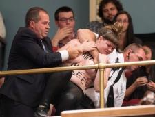 Topless activist storms Quebec legislature