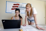 Ashley Hentze, left, of Lakeland, Fla., gets help signing up for health care from Kristen Nash, a volunteer with Enroll America, a private, non-profit organization running a grassroots campaign to encourage people to sign up for health care, Tuesday, Oct. 1, 2013. (AP / Chris O'Meara)