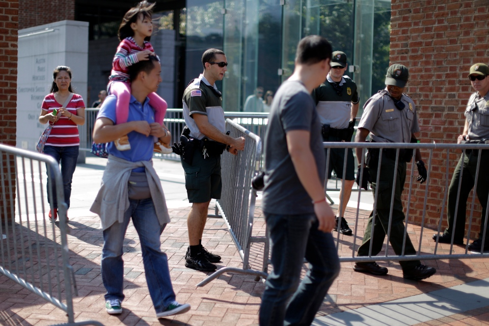 Park Rangers erect barricades as tourists at Independence National Historical Park in Philadelphia look on, on Tuesday, Oct. 1, 2013. (AP / Matt Rourke)