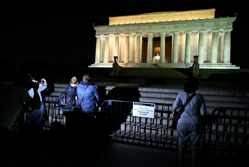 People take pictures in front of the steps of the closed Lincoln Memorial, Tuesday, Oct. 1, 2013, in Washington. (AP / Alex Brandon)