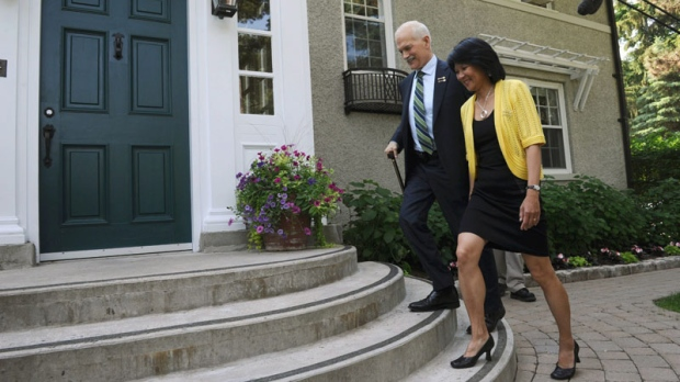 New Democratic Party leader Jack Layton and NDP MP Olivia Chow walk up to the entrance of Stornoway, the house of the leader of the opposition in Ottawa, on Wednesday, June 15, 2011. (Sean Kilpatrick / THE CANADIAN PRESS)