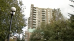 The highrise condo building where six men were gunned down is seen in Surrey, B.C.