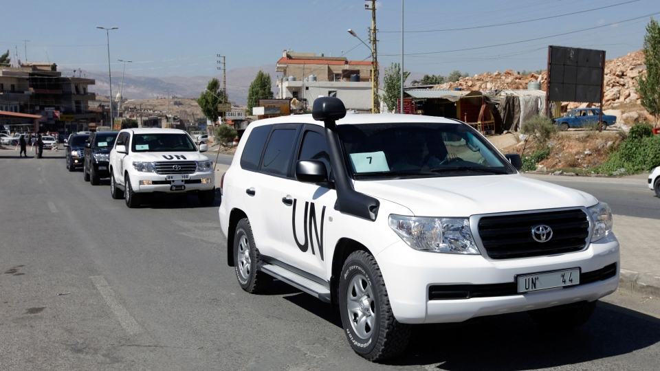 A convoy of inspectors from the Organization for the Prohibition of Chemical Weapons prepares to cross into Syria at the Lebanese border crossing point of Masnaa, eastern Bekaa Valley, Lebanon, Tuesday, Oct. 1, 2013. (AP / Bilal Hussein)
