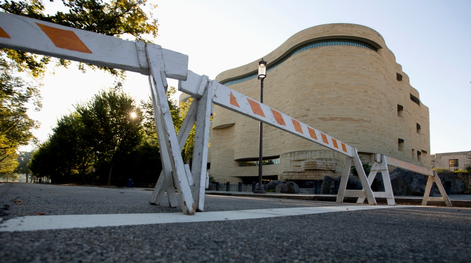 Barricades are posted in front of the closed Smithsonian National Museum of the American Indian in Washington, Wednesday, Oct. 2, 2013. (AP / Carolyn Kaster