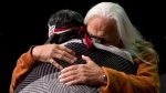 Residential school survivor Joe George, right, of the Tsleil-Waututh First Nation, and elder Marie George embrace during the Truth and Reconciliation Commission of Canada British Columbia National Event in Vancouver, on Wednesday, Sept. 18, 2013. (Darryl Dyck / THE CANADIAN PRESS)