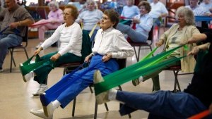 The Reynoldsburg Senior Center participants Eva Mae Bullen in white, left, and Marilyn O'connor use rubber straps to exercise during an hour long workout, Jan, 10, 2011 in Columbus, Ohio. (AP Photo/Columbus Dispatch, Jeff Hinckley)