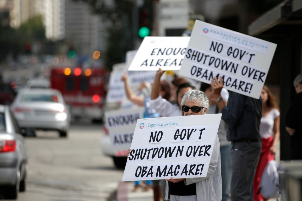 Barbara Samuels, 86, joins dozens others to protest against the government shutdown outside the federal building in Los Angeles on Wednesday, Oct. 2, 2013. (AP / Jae C. Hong)