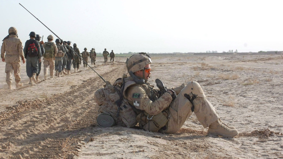 Former Cpl. John Lowe rests during an operation in Panjwaii, Afghanistan, on March 23, 2010. (Murray Brewster / THE CANADIAN PRESS)