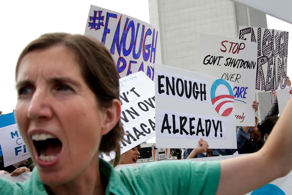 Vicki Maturo, of Culver City, Calif., chants during a protest against the government shutdown outside the federal building in Los Angeles on Wednesday, Oct. 2, 2013. (AP / Jae C. Hong)