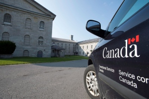A Corrections Canada vehicle sits on inner side of the main gatehouse of Kingston Penitentiary in Kingston, Ont. on Wednesday, Oct. 2, 2013. (Frank Gunn / THE CANADIAN PRESS)