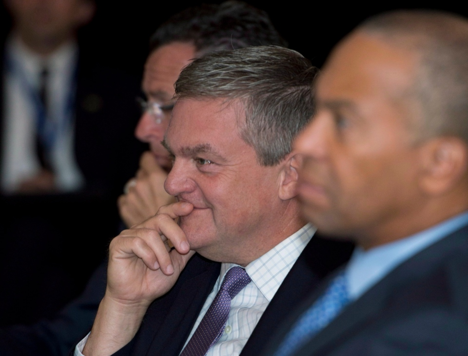 New Brunswick Premier David Alward, centre, and Massachusetts Governor Deval L. Patrick, right, listen to the plenary session on climate change at the 37th annual conference of the New England Governors and Eastern Premiers in La Malbaie, Que., Monday, Sept. 9, 2013. (Jacques Boissinot / THE CANADIAN PRESS)