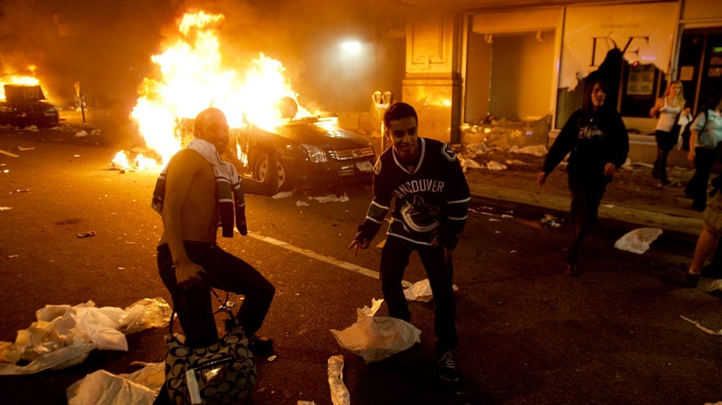 Vancouver Canucks hockey fans take part in a riot in downtown Vancouver following the Vancouver Canucks 4-0 loss to the Boston Bruins in game 7 of the Stanley Cup hockey final on Wednesday, June 15, 2011. (Ryan Remiorz / THE CANADIAN PRESS)