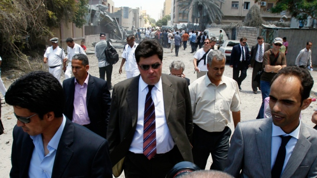 Russian presidential envoy Mikhail Margelov, centre, visiting a bombing site in Tripoli, Libya, on Thursday, June 16, 2011. (AP / Ivan Sekretarev)