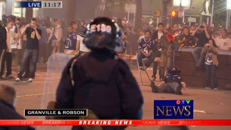 Riot police prepare to confront crowds in downtown Vancouver near Robson and Granville streets. June 15, 2011. (CTV)