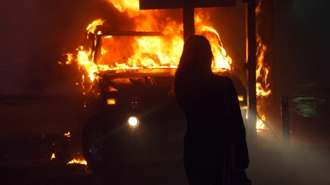MyNews contributor Vikram Singh shared this photo of a vehicle engulfed in flames during a riot following game 7 of the NHL Stanley Cup final in downtown Vancouver on Wednesday, June 15, 2011. (Vikram Singh / MyNews.CTV.ca)