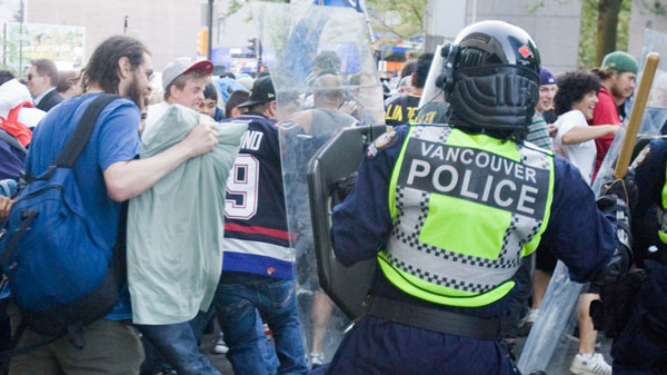 Vancouver Canucks fans riot following game 7 of the NHL Stanley Cup final in downtown Vancouver, B.C., on Wednesday, June 15, 2011. (Geoff Howe /THE CANADIAN PRESS)