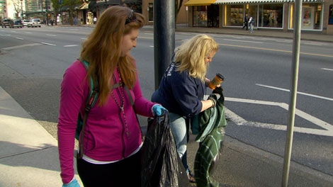 Erin McDougall and Karami Csizmadia came downtown Vancouver to clean up after the post-Stanley Cup riot.  June 16, 2011. (CTV)