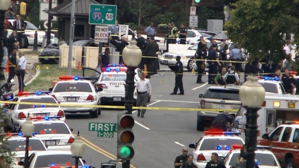 Dozens of police officers surround Capitol Hill, where a security lockdown is underway after reports of shots fired.