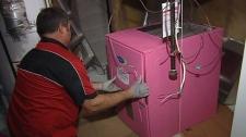 Technicians install new pink furnace