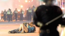 Vancouver couple apparently kissing during riot.