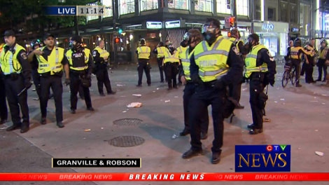 Riot police gather near the intersection of Granville and Robson streets in downtown Vancouver in the aftermath of the Canucks' 4-0 loss to the Boston Bruins in Game 7 of the Stanley Cup Final. June 15, 2011. (CTV)