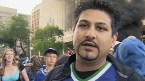 A Vancouver Canucks fan says the riots are 'awful' and he is embarrassed by them, Wednesday, June 15, 2011.