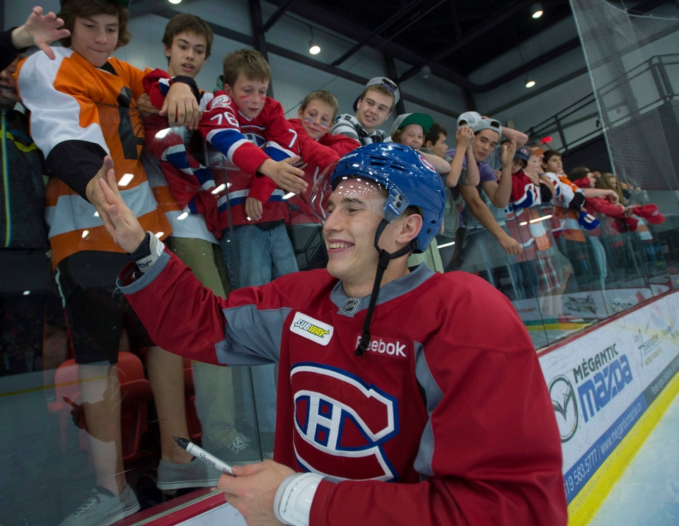 Montreal Canadiens right wing Brendan Gallagher shakes hands with fans after the team's practice in Lac-Megantic, Que., Thursday, Oct. 3, 2013. (Ryan Remiorz / THE CANADIAN PRESS)