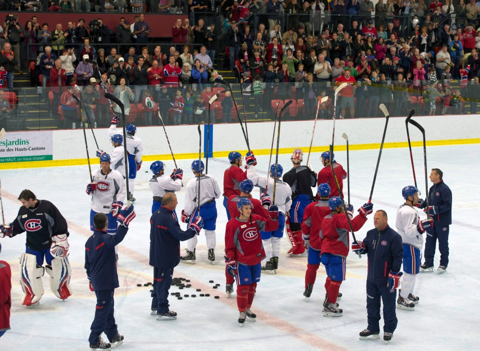 Montreal Canadiens salute the crowd after the team's practice in Lac-Megantic, Que., Thursday, Oct. 3, 2013. (Ryan Remiorz / THE CANADIAN PRESS)