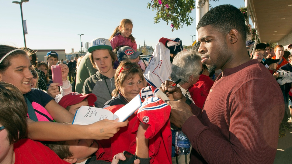 Montreal Canadiens defenseman P.K. Subban signs autographs after the team's practice in Lac-Megantic, Que. on Thursday, October 3, 2013. (Ryan Remiorz / THE CANADIAN PRESS)