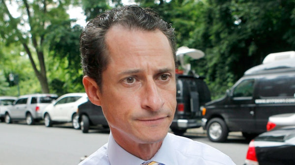 Anthony Weiner returns home after he announced his resignation from Congress in the Queens borough of New York, Thursday, June 16, 2011. (AP / Jason DeCrow)