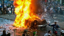 MyNews contributor Adrian Geromimo captured this photo of a truck on fire after being overturned by rioters following game 7 of the NHL Stanley Cup final in downtown Vancouver on Wednesday, June 15, 2011. (Adrian Geronimo / MyNews.CTV.ca)