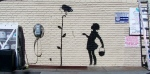 The Banksy graffiti mural entitled, 'Flower Girl,' which formerly occupied a gas station in Los Angeles. (AP / Julien's Auctions)