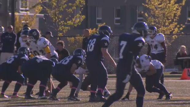High school football team practices