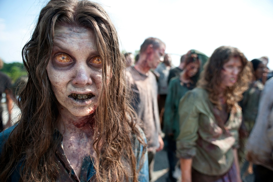 "In this image released by AMC, zombies appear in a scene from the second season of the AMC original series, ""The Walking Dead,"" in Senoia, Ga.  (AP Photo/AMC, Gene Page)"