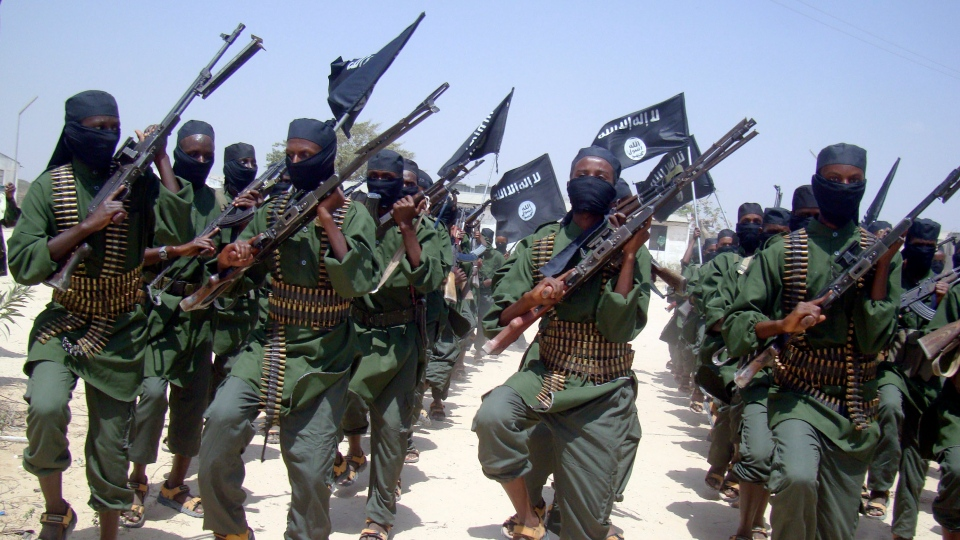 Al-Shabaab fighters march with their weapons during military exercises on the outskirts of Mogadishu, Somalia, Thursday, Feb. 17, 2011. (AP / Mohamed Sheikh Nor)