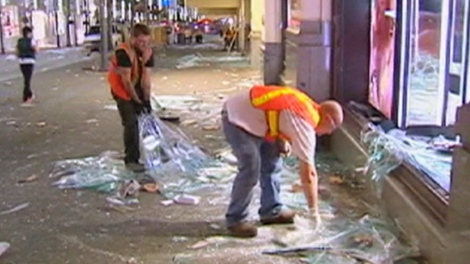 City crews cleanup the damage in Vancouver, B.C. on Friday, June 17, 2011.