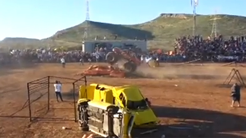 Video image of a monster truck leaping an obstacle at the 'Extreme Aeroshow' in Mexico on Saturday, Oct. 5, 2013. (Youtube)