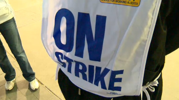 A Superstore employee wearing an 'on strike' vest