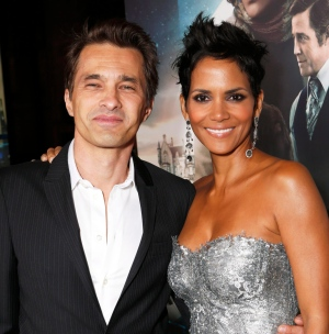 Actors Olivier Martinez, left, and Halle Berry pose at the Los Angeles premiere of Berry's film 'Cloud Atlas' in Hollywood, Oct. 24, 2012. (Todd Williamson / Invision)