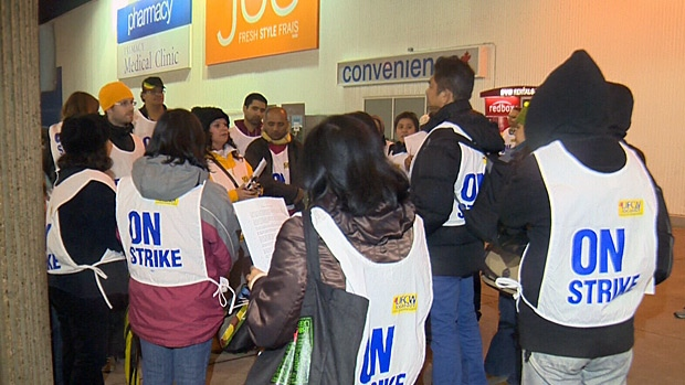 Superstore employees gather outside of a store in Edmonton