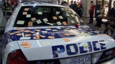 People leave messages of thanks on Post-it notes on a Vancouver police cruiser parked in the city's downtown core. June 17, 2011. (CTV)